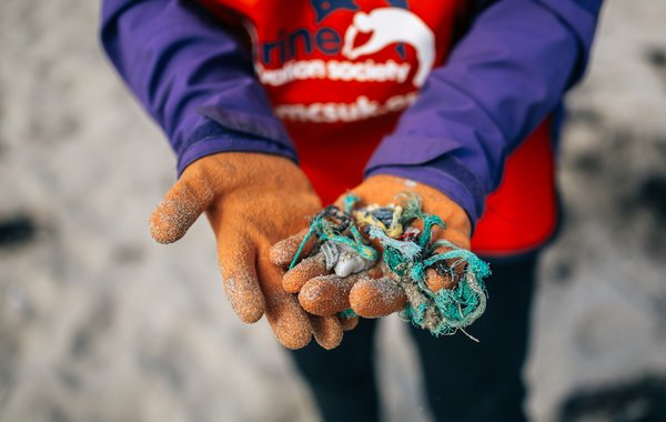 Plastic and netting in hands Porthtowan Beach Great British Beach Clean GBBC 2015 Natsha Ewins