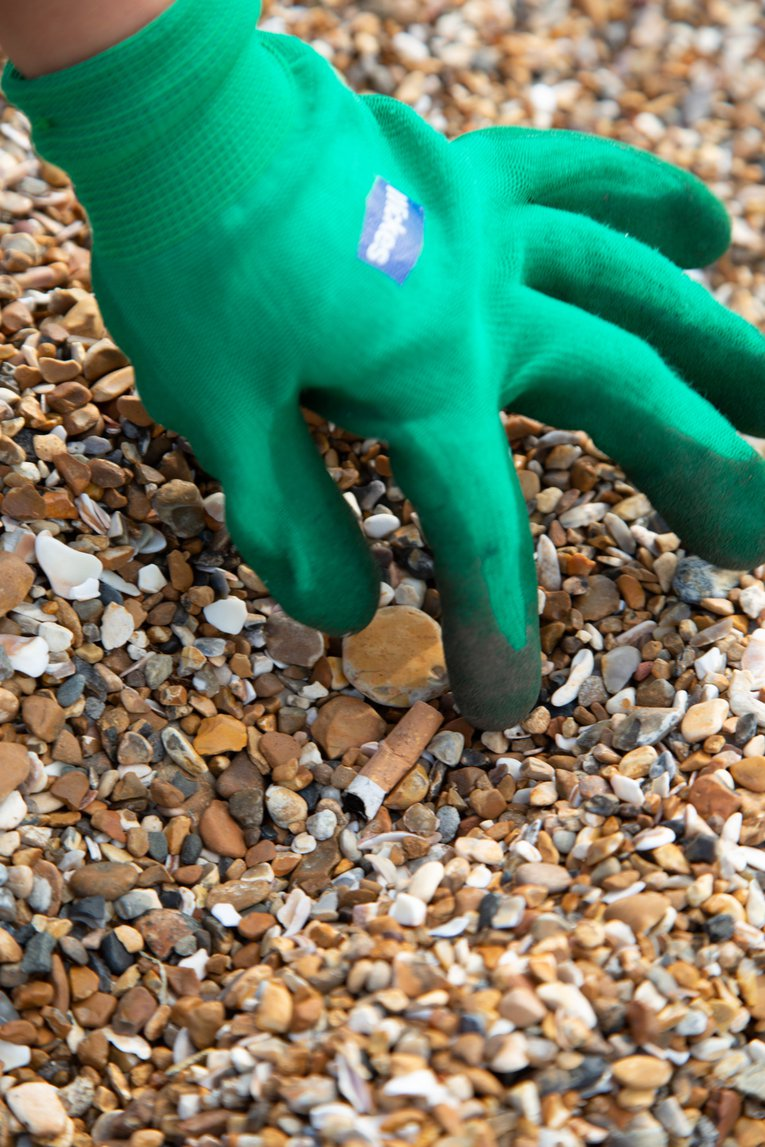 cigarette butt pick up at Great British Beach Clean at Hove Beach Brighton Billy Barraclough