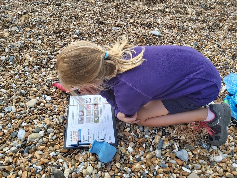 Filling in the litter survey during the Great British Beach Clean 2020 Kate Whitton