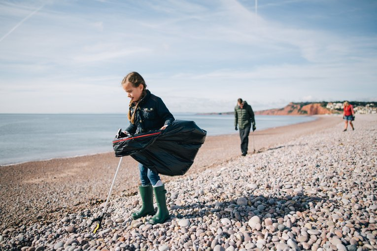 Young volunteer at the Great British Beach Clean on Budleigh Beach Andrew Brown