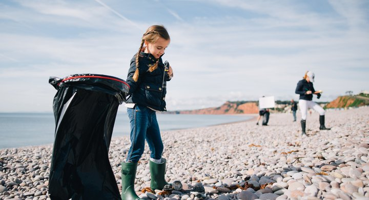 Young volunteer during Great British Beach Clean on Budleigh Beach GBBC 2017 Andrew Brown