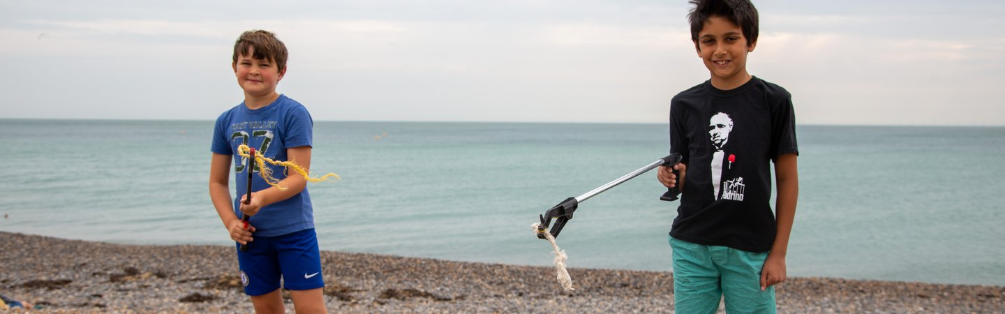 Children litter picking at the Great British Beach Clean on Rottingdean beach 2020 Billy Barraclough