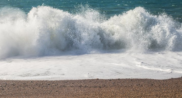 Waves break on Chesil Beach Natasha Ewins