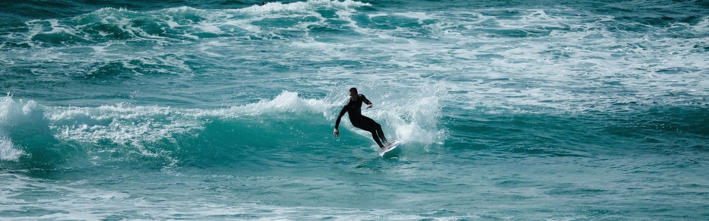 Surfer at Fistral Beach Carter Moorse